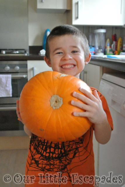 ethan holding pumpkin