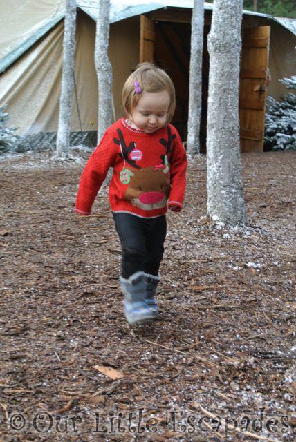 little e walking around elf village lapland uk superstar day