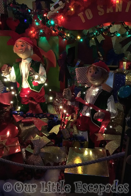 elves gift wrapping grotto scene