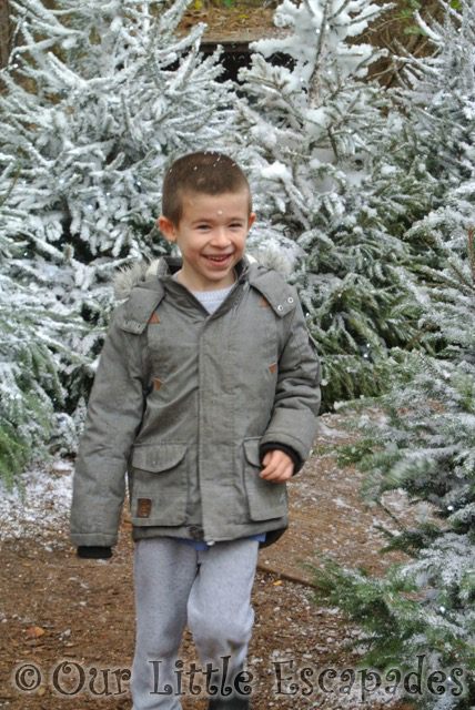 ethan running through snow santas woodland workshop center parcs elveden forest