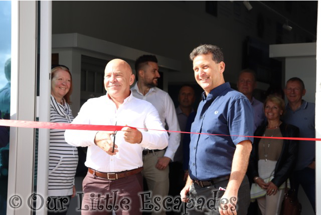 dominic littlewood ribbon cutting seh bac showroom colchester grand opening