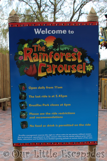 rainforest carousel opening sign drusillas park