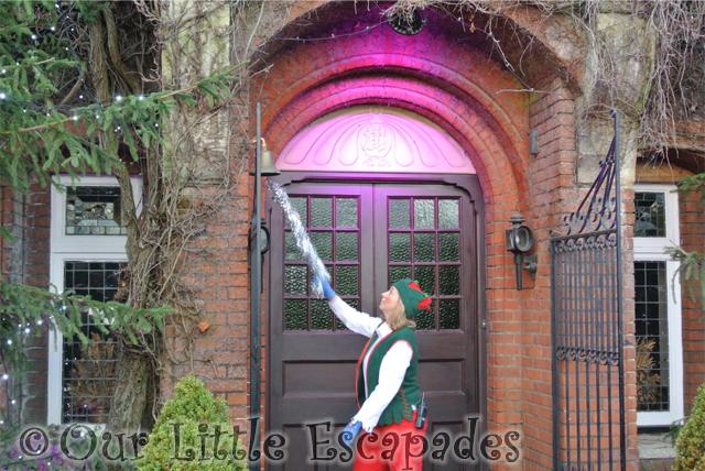 elf ringing santas doorbell breakfast with santa colchester zoo