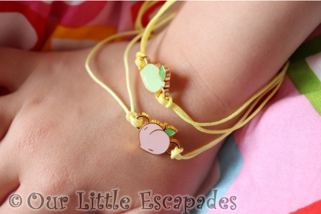 little e lucky fortune collectible bracelet peach lime charm