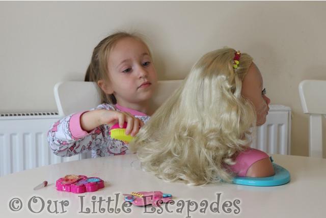 little e brushing hair