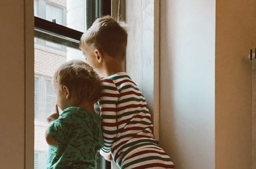 two boys looking outside window 3273852 featured image