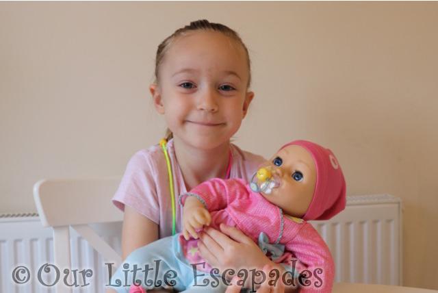little e holding elli smiles
