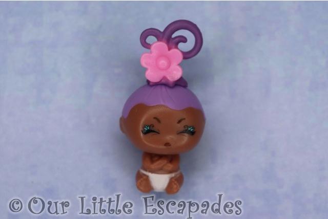 pink flower purple curls adorable poopy baby blume baby pop