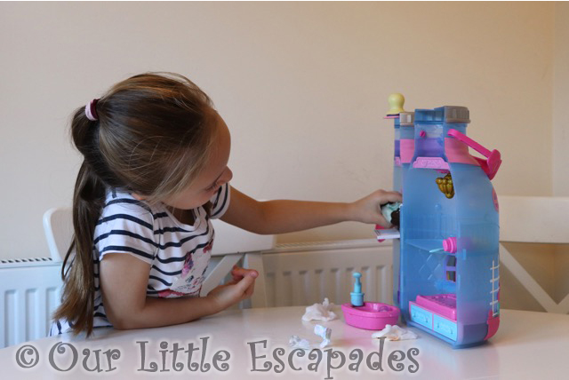 little e playing baby bottle house baby born surprise